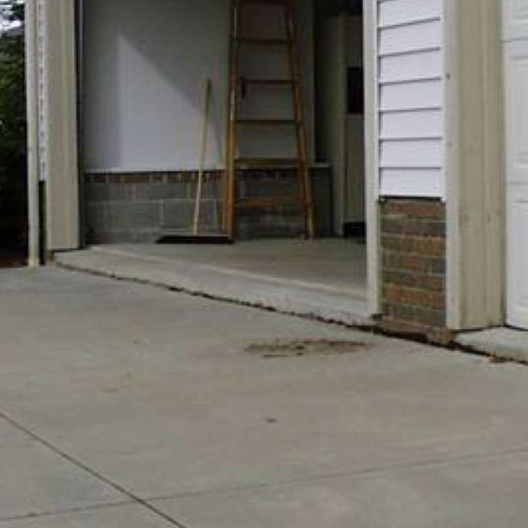 Concrete Driveway Leveling - Before